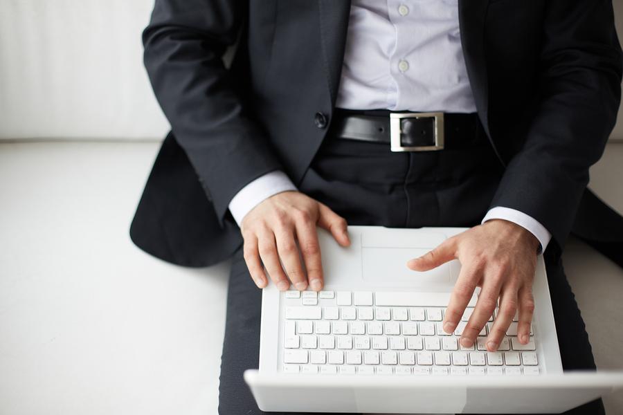 Startup founder typing on laptop